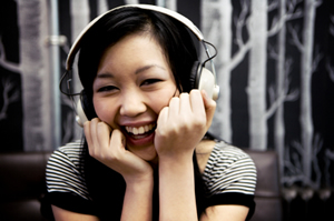smiling-woman-japanese-listening-to-music-headphones.jpg