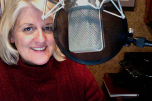 Voice artist Tami Romani with microphone 12-12-12 December 12, 2012