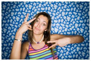 Teenage girl gesturing, peace signs