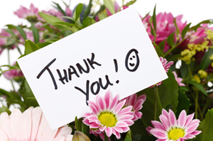 Thank you note on a bright bouquet of flowers