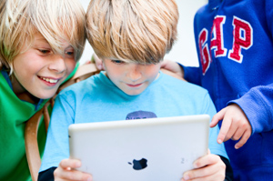 three-young-british-boys-looking-at-an-ipad.jpg