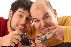 Two men playing video games, holding controllers