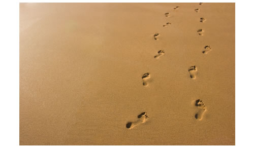 two-sets-of-footprints-sand.jpg