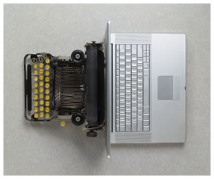 Typewriter beside a MacBook Pro