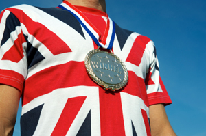 Man wearing a Union Jack t-shirt with an Olympic medal around his neck, showing shirt only and cut off just above the shoulders.  London 2012