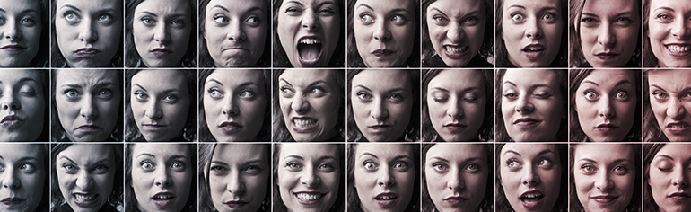 Variety of moods and emotions displayed on an actress' face. Range of feelings including joy, anger, fear and grief.
