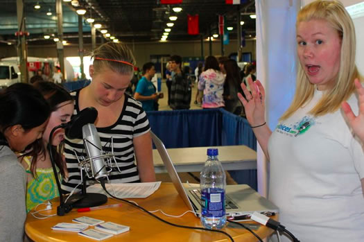 Whitney Stewart of Voices.com recording students at SLOME 2011