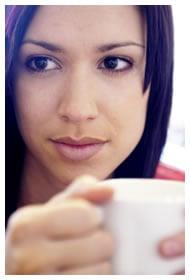 Woman drinking coffee or tea