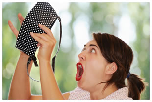 Woman screaming holding an empty purse