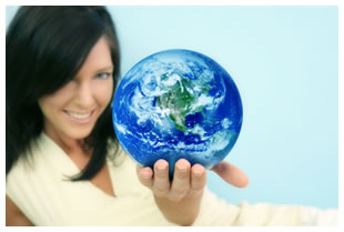 Woman (brunette) holding a globe in her hands, presenting it to the viewer