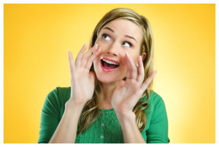 Woman cupping her mouth with her hands, green shirt, blonde hair, yellow background