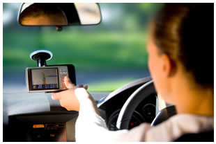 Woman looking at her GPS in the car