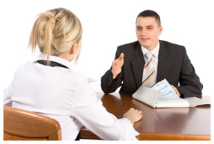 Woman and man sitting down for a job interview