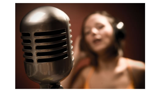 woman behind microphone out of focus