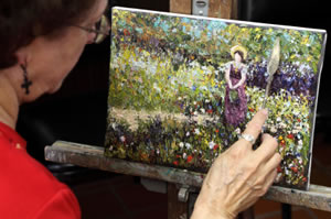 Woman painting in an Impressionist style