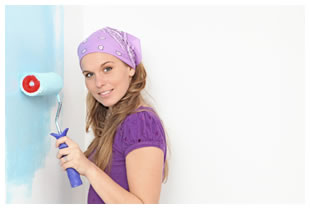 Woman using a paint roller