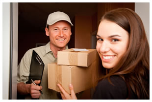 Woman receiving a package from a delivery man
