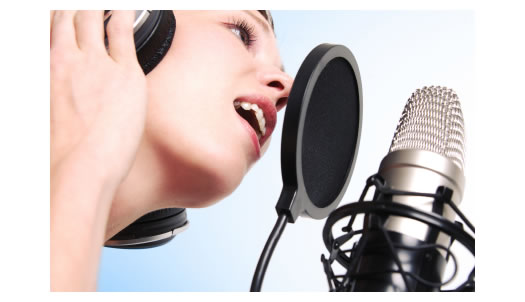 http://blogs.voices.com/voxdaily/woman-recording-microphone-ear-phones.jpg