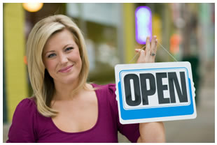 Woman smiling her store is open for business