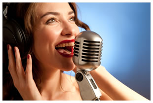 Brunette singing into a microphone vintage style