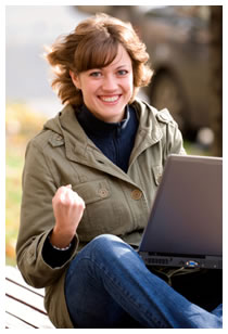 Woman enjoying her success laptop