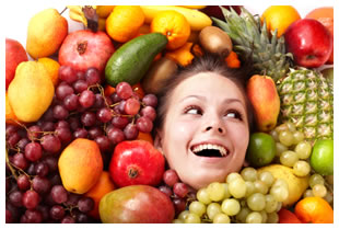 Woman's face surrounded by fruit
