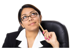 Woman sitting at her desk and thinking