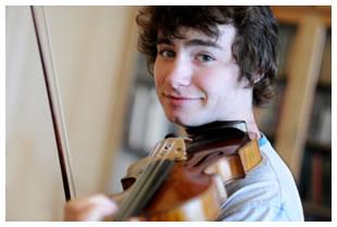 Young man practicing violin